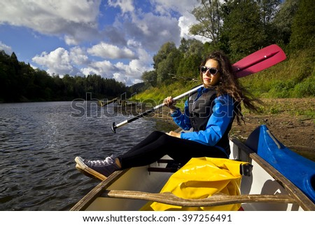 young woman with paddle - stock photo