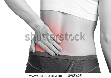 Young woman with pain in her lower back - stock photo