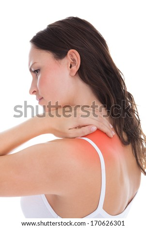 Young Woman With Pain In Her Shoulder Over White Background - stock photo