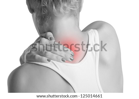 Young woman with pain in the back of her neck, black and white, red spot around painfull area - stock photo