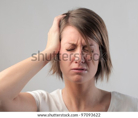 Young woman with painful expression