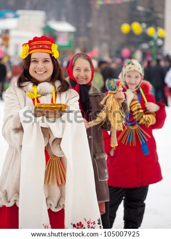 Young woman with pancake during  Shrovetide at Russia