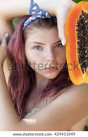 Young woman with papaya