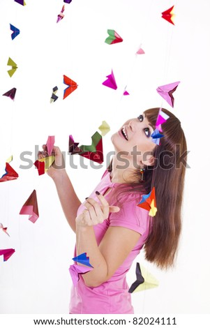 Young woman with paper airplanes - stock photo