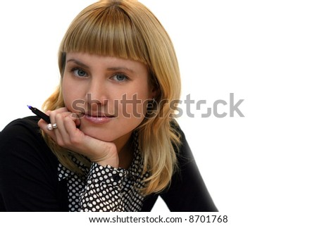 young woman with pen in office - stock photo
