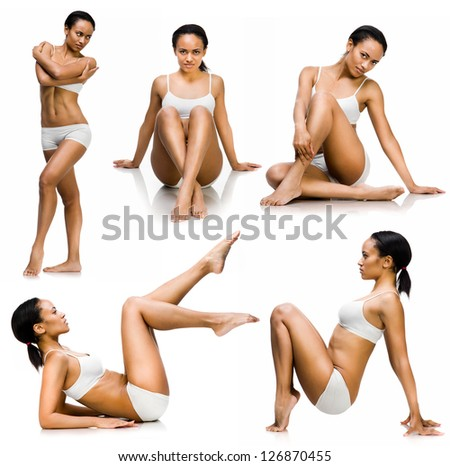 young woman with perfect body sits on a white background. set - stock photo