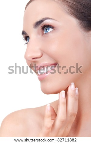 young woman with perfect skin on her face, close up, isolated on white background - stock photo