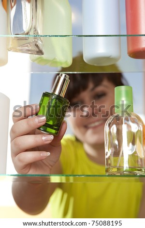 Young woman with perfume - stock photo