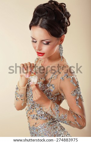 Young Woman with Perfume Bottle. Fragrance - stock photo