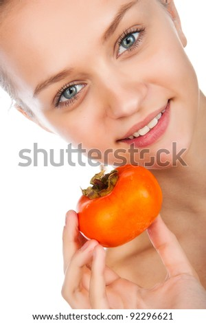 young woman with persimmon against white background