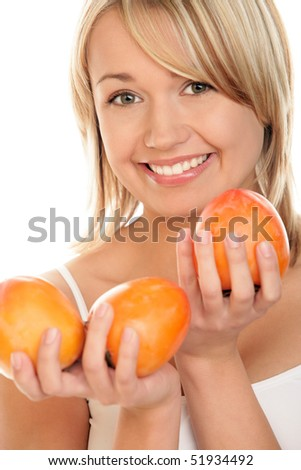 Young woman with persimmons. Focus on face. - stock photo