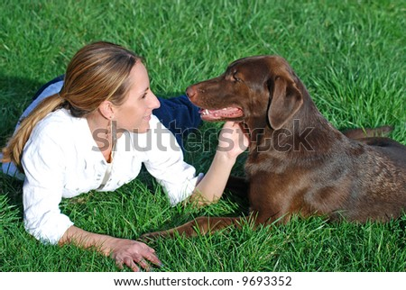Young woman with pet dog - stock photo