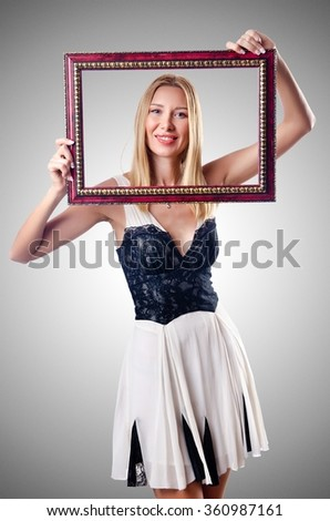 Young woman with picture frame on white - stock photo