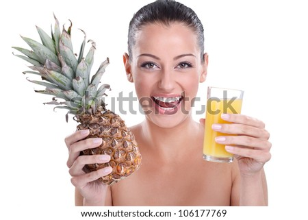 young woman with  pineapple fruit juice smiling and  showing pineapples - stock photo