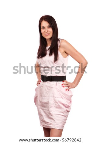 Young woman with pink dress isolated on white background - stock photo