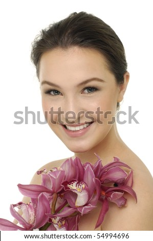 young woman with pink orchids - stock photo