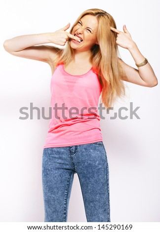 Young woman with pink shirt in studio. / Happy beautiful blonde isolated on white - stock photo