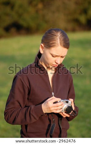 Young Woman with Point and Shoot Camera - stock photo