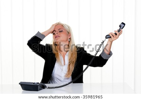 Young woman with problems and stress in the office