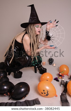 Young woman with pumpkin and Halloween setting