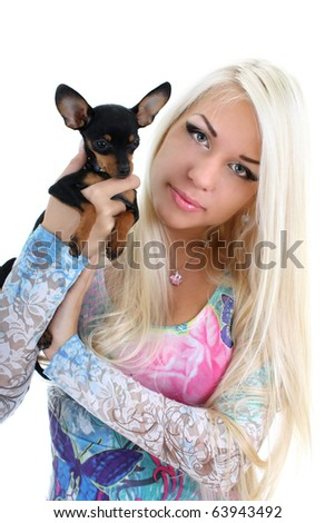 young woman with puppy in her hand isolated over white