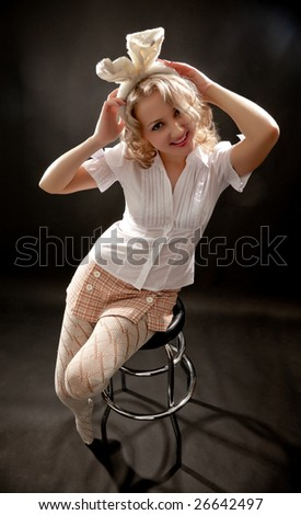 Young woman with rabbit's ears sitting on a bar chair