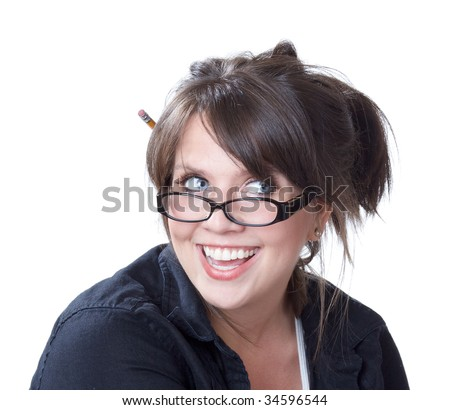 Young woman with reading glasses laughs and looks off to her left; close-up; isolated on a white background.