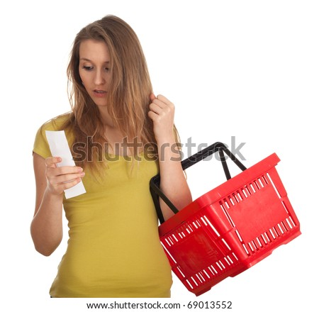 young woman with red basket checking purchases list - stock photo