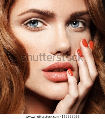 Young woman with red lips and colorful manicure, shine hair - stock photo