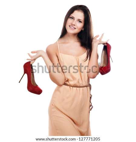 Young woman with red shoes - stock photo