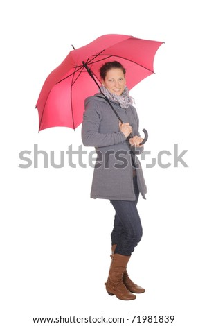 young woman with red umbrella - stock photo