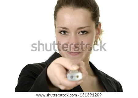 Young woman with remote control / laser pointer, studio shot