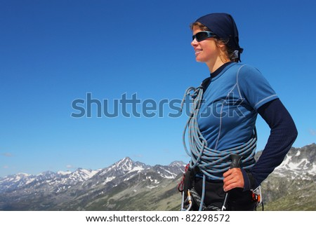 Young woman with rope with large copy space - stock photo