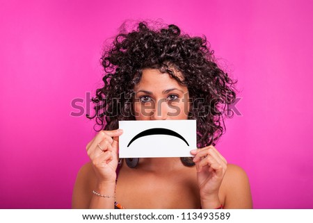 Young Woman with Sad Emoticon on Fuchsia Background - stock photo