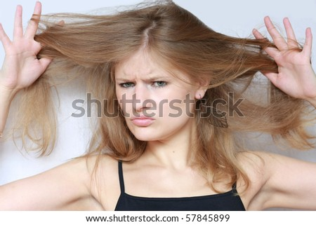 young woman with sad expression. hair style