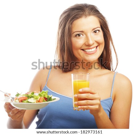 young woman with salad and orange juice
