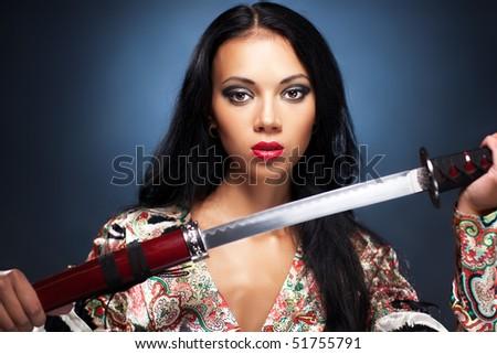 Young woman with samurai sword fashion. - stock photo