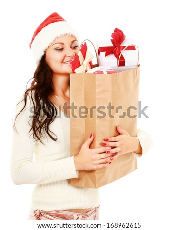 Young woman with Santa hat holding shopping bags, isolated on white background - stock photo