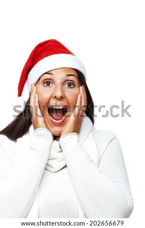 Young woman with santa hat surprised