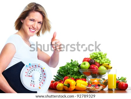 Young woman with scales and vegetables. Diet and fitness. Isolated ver white background - stock photo