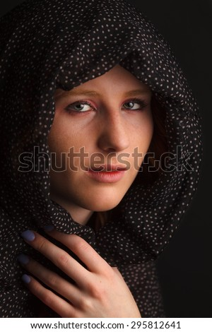 Young woman with scarf over her head - stock photo