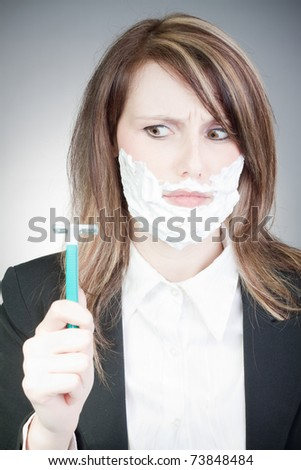 young woman with shaver on her face