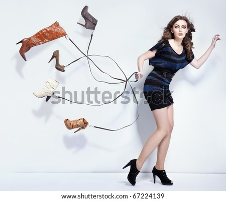 Young woman with shoes - stock photo