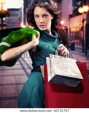 Young woman with shopping bag - stock photo