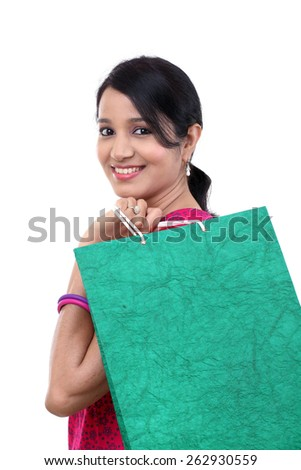 Young woman with shopping bag against white - stock photo