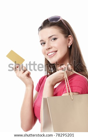 Young woman with shopping bags and credit card on a white background