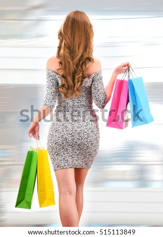 Young woman with shopping bags in commercial center