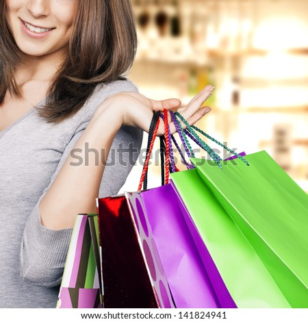Young woman with shopping bags in hand