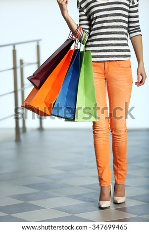 Young woman with shopping bags in the mall - stock photo