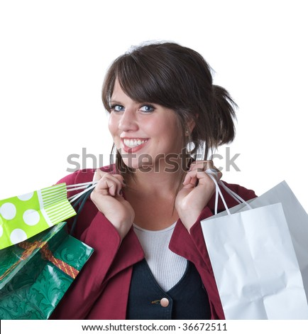 Young woman with shopping bags; isolated on a white background. - stock photo